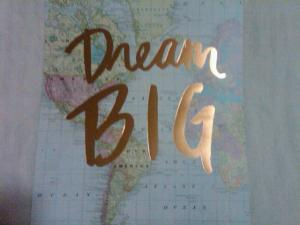 The message Dream Big overlayed on a map.